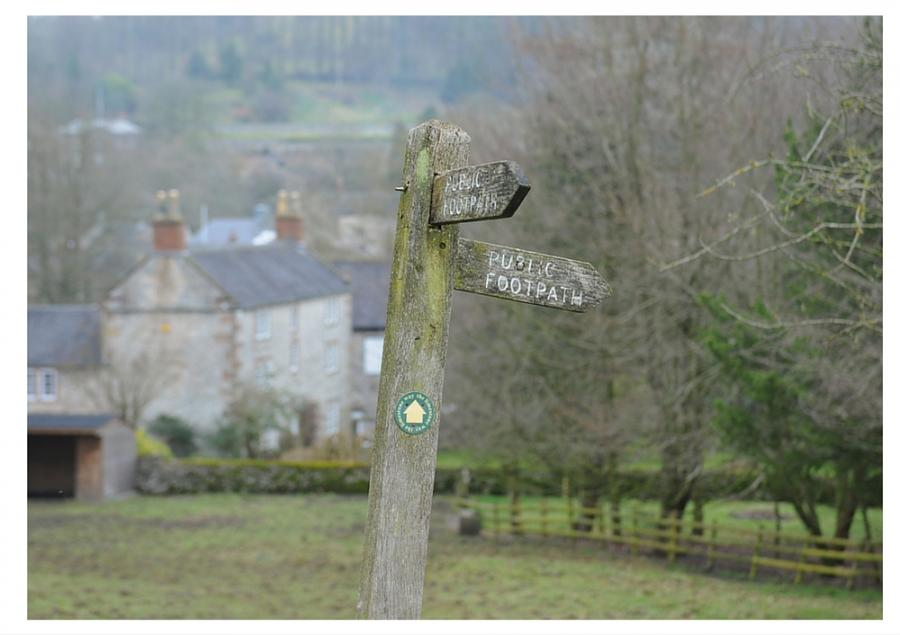 A footpath sign in rural England for an article on the best walks in England and Wales