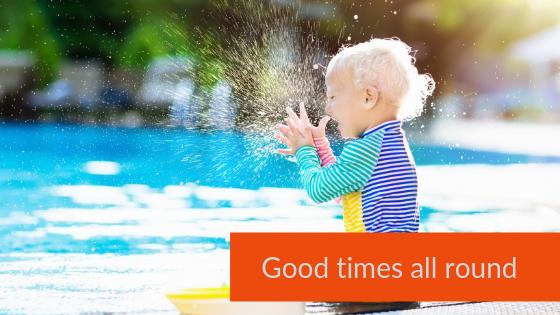 Toddler splashing in pool - baby and toddler friendly cottages, family holidays uk