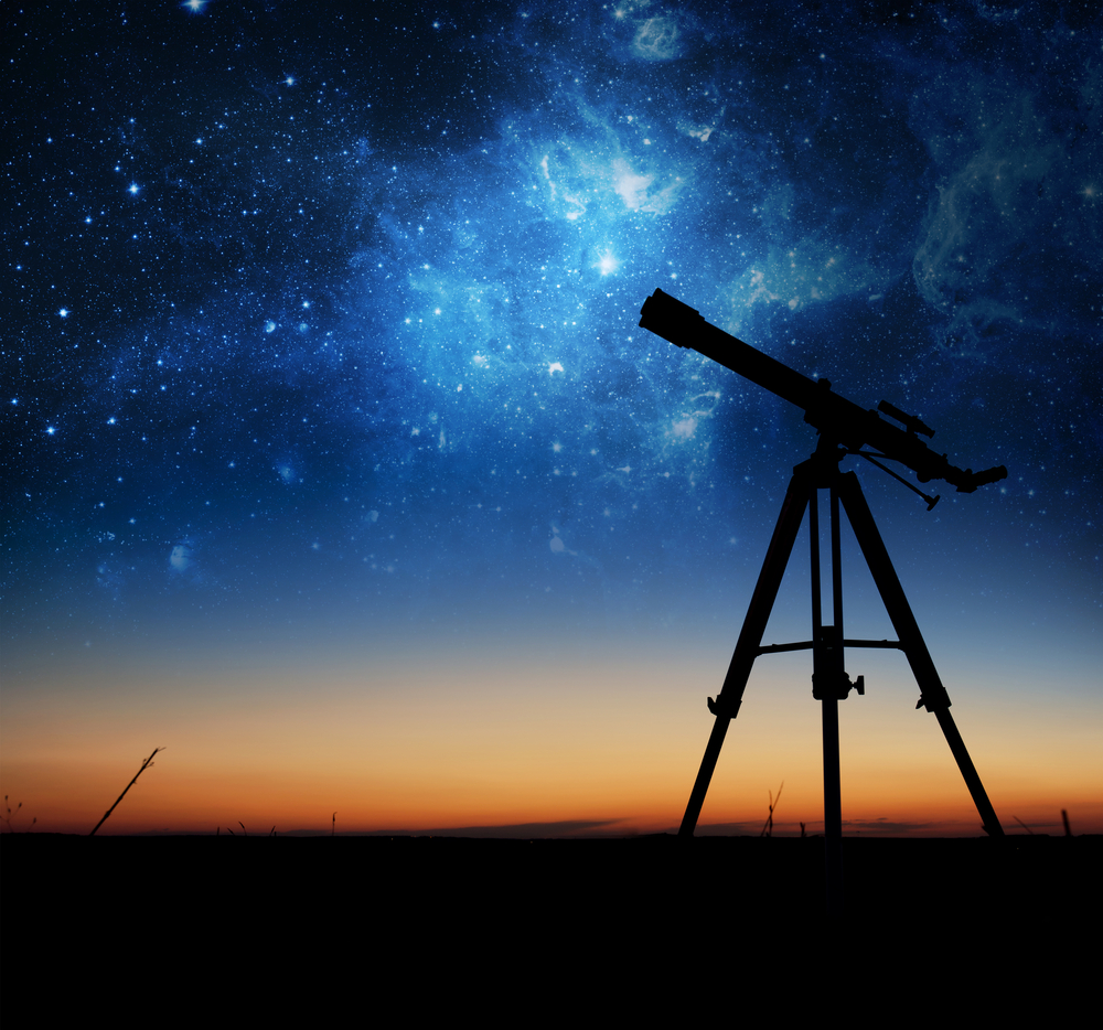 Telescope looking up at the night sky